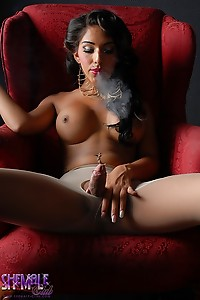 Smoking hot Jane Marie shows off how massive her T-girl dick that it will destroy your ass