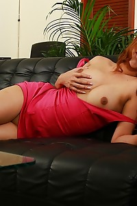 Watch the red hot Balloon jacking her massive dong on a black couch
