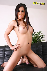 Cute transsexual Lucky stripping and posing