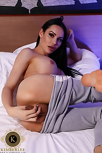Kimberlee just woke up super horny, she pleasures her dick and makes a creamy mess on bed