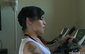 Shemale bangs big cock guy in gym