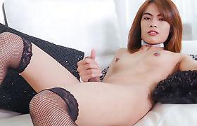 Hot asian brunette tranny Gigi B masturbates her shaft