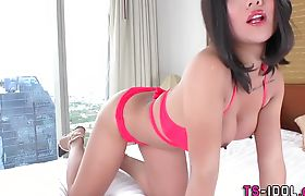 Ladyboy asian tugs her dick and cums