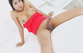 Busty shemale shows off her ass and playing with her cock