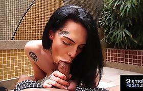 Sexy brunette shemale Gabi Ink sucking on fat cock