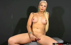 Blonde tgirl reveals massive boobs and jerks off shaved cock