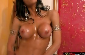 Shedoll teases perfectly oiled round tits and shaved shecock