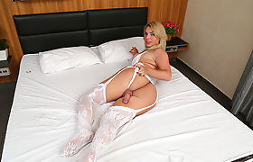 Naughty shemale Carol Penelope takes a fat cock in her ass