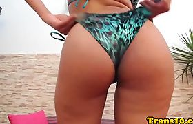 Transsexual beauty plays with her sexy body