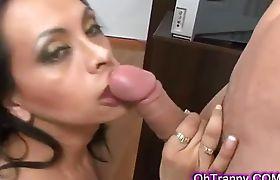 Sexy brunette tranny sucking throbbing cock