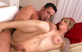 Blonde tranny Nina Lawless gets naked and anal fucked hard