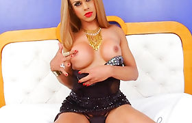 Lusty blonde tranny strokes her hard cock until she cums