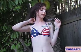 Tattooed shemale teases her cock outdoors
