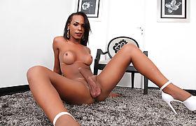 Busty ebony Tbabe jerks off her black shecock until she cums