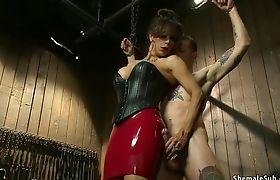 Busty TS dom anal fucks slave man