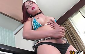 Asian ladyboy jerks off and creams