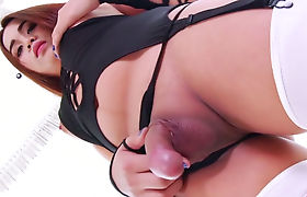 Cute ladyboy in stockings playing with her girly cock