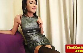 Solo asian shemale in stockings masturbating