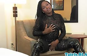 Busty solo tranny strokes her black dong