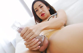 Sexy brunette shemale fucks her cock with a fleshlight