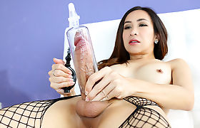 Asian shemale using a penis pump