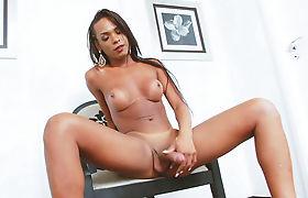 Busty ebony shemale Anny Kelly masturbates her black shecock