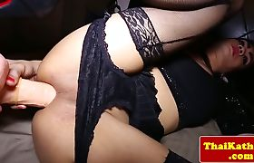 Thai amateur ts in lingerie shoves toy in ass