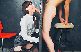 Ts Natalie Mars sucking a guys big cock through a glory hole