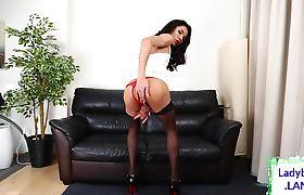 Crimson lipped ladyboy jerks her dick off