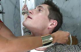 Busty TS anal fucks man in restroom