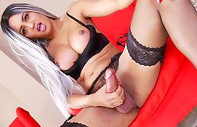 Glamorous shemale Bella playing with her huge anaconda
