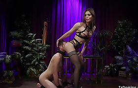 Shemale in lingerie dominates man