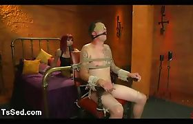 Bound gagged guy flogged by redhead tranny
