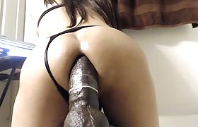 Tranny Destroying Her Butt With A Monster Dildo