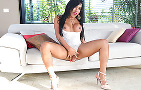 Latina TS Aylla enjoys solo masturbation on her first scene