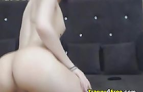 Very pretty shemale shows and plays with big lady cock