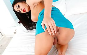 Stunning Asian tranny Seang masturbates her cock on the bed
