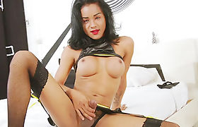 Busty Asian ts Emma C showing off her tight body and jerking