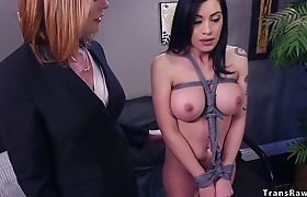 Tied up busty Latina banged by tranny