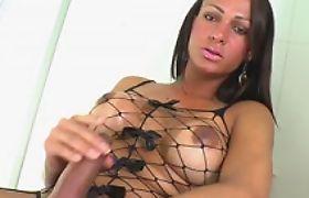 Sexy shemale Lauany Biencontty masturbates her big cock