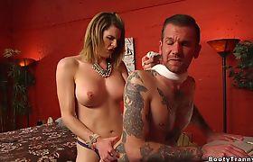 Busty tranny dominates and fucks tattooed guy