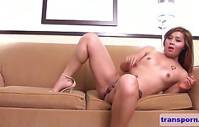 Trans babe fingering her asshole on the couch