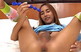 Brown skinned Thai ladyboy ready to get her ass filled