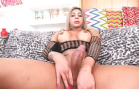 Busty blonde Shemale Nicoly Evans teasing and masturbating