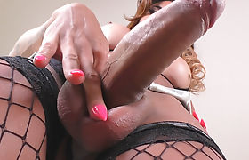 TS Keylla Marques Loves To Stroke Her Huge Cock