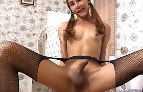 Flat ladyboy with pigtails bending over for a POV cock