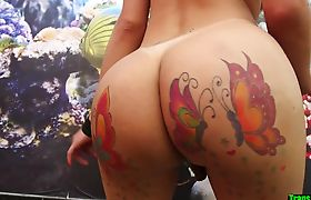 Ass tattooed tgirl sucks interracial cock