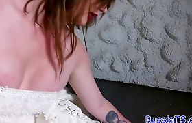 Glam russian tranny tugging her cock