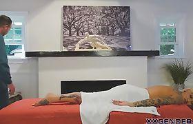 Tattooed buxom blonde tranny