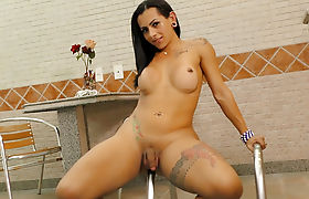Tattooed Transsexual Strips Naked for You